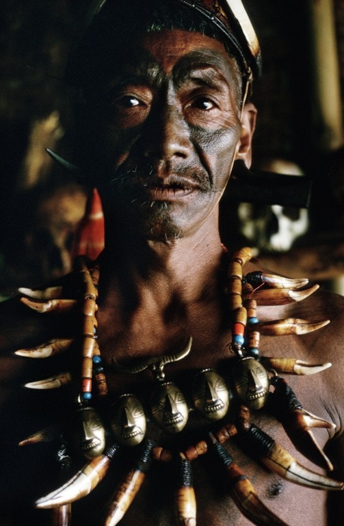 An old Konyak warrior with a tattooed face.