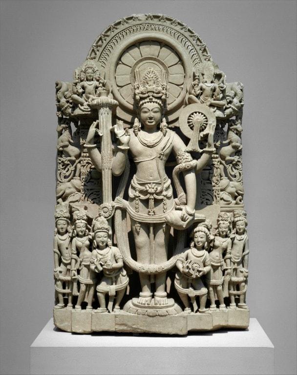Vishnu with makara figures at the edge