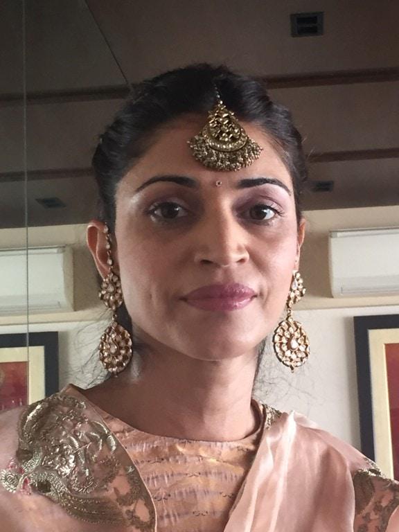 Gayatri with maang tikka and earrings
