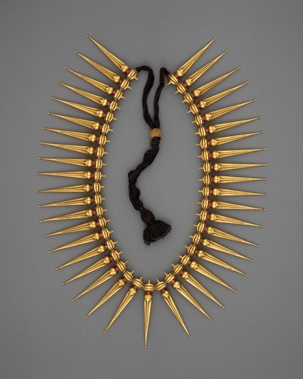 Jasmine Bud Necklace (Malligai Arumbu Malai),19th century. Ruby and gold. Met Museum.