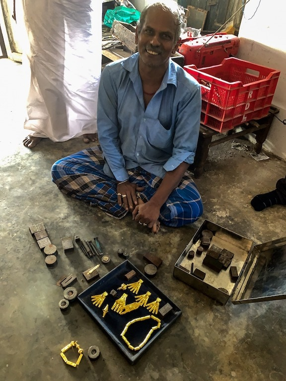 Jeweller with the metal die in which the kalathiru parts are cast.
