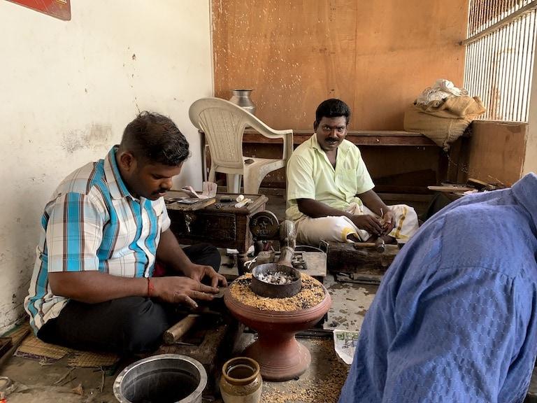 Three jewellers working on creating the kalathiru necklace