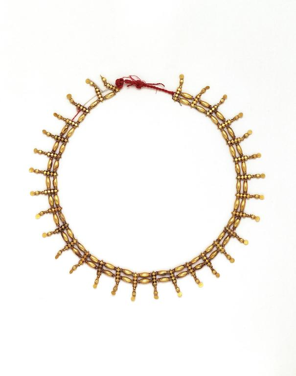 Gold necklace formed of two rows of long gold beads strung on red silk threads. Each bead is separated from its fellow by flexible pendent ornaments. Vellore. Made in 1880