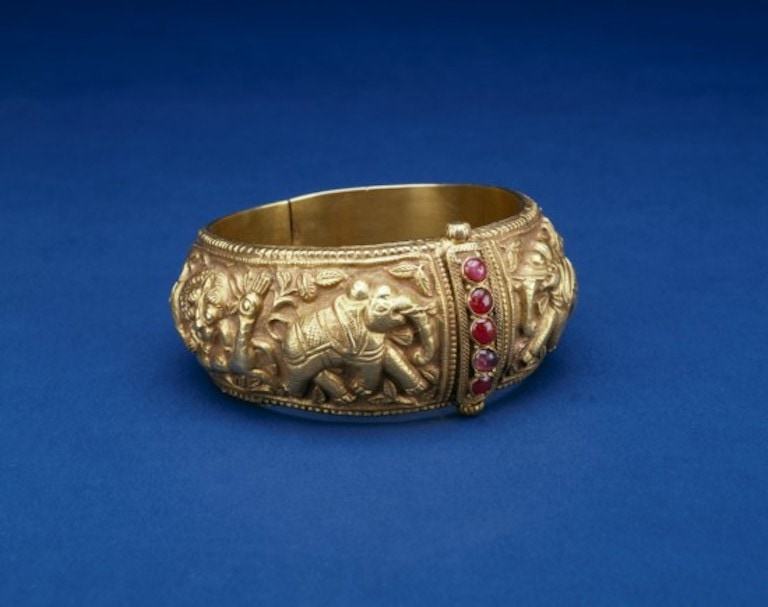 19th century valai or bangle. Gold embossed with elephants and old rubies. MFA, Houston.