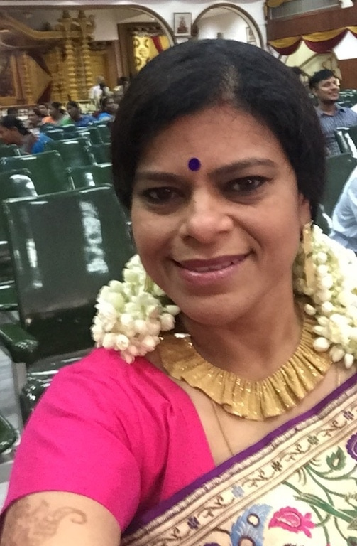 Sujatha in a gold necklace she got in Dubai.
